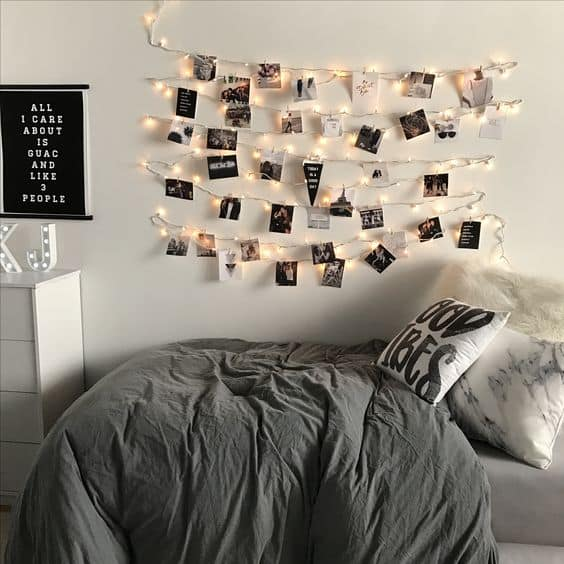 pictures strung on lights in a dorm room