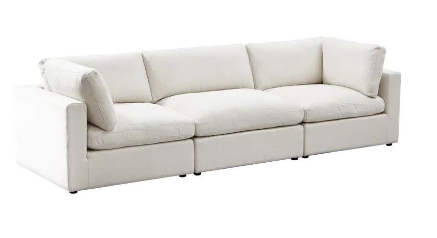 living rooms with white couches